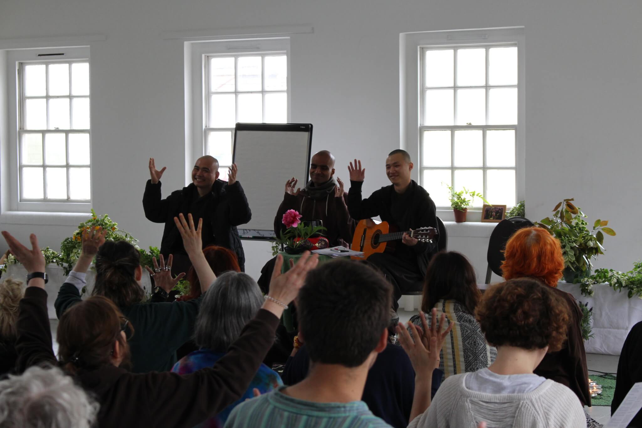 Monastic and practitioners at London hub