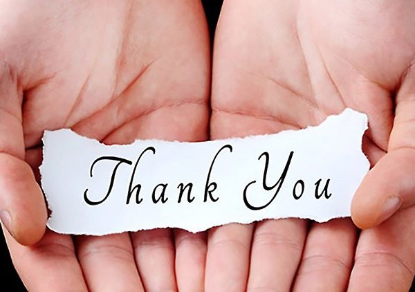 hands holding thank you note