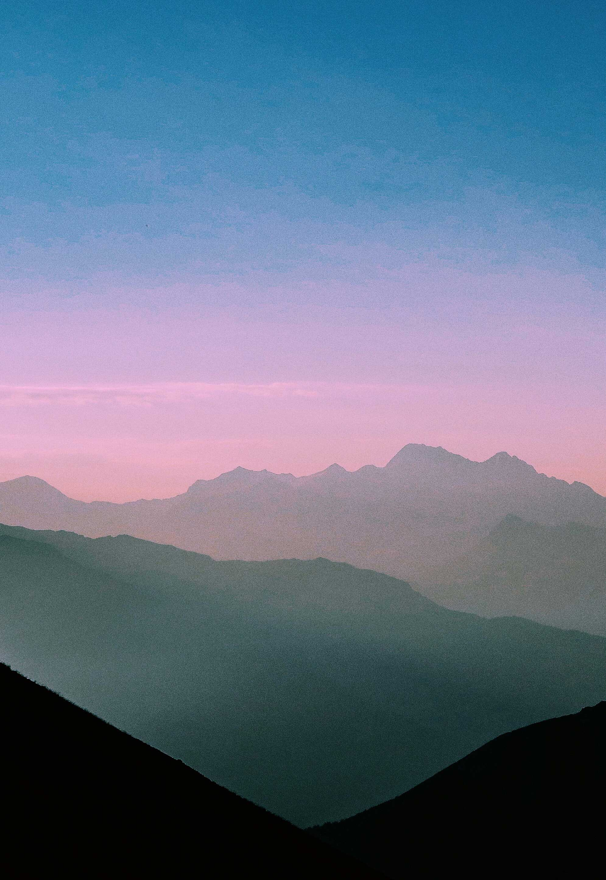 hazy sunset over mountains