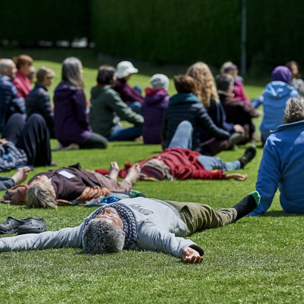 Retreat participants laying on grass